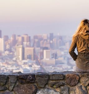 An expat looking at a city skyline