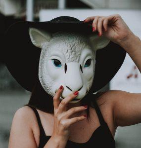 Woman wearing a sheep's mask