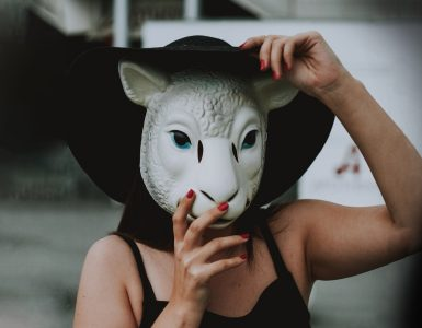 Woman wearing a sheep's mask