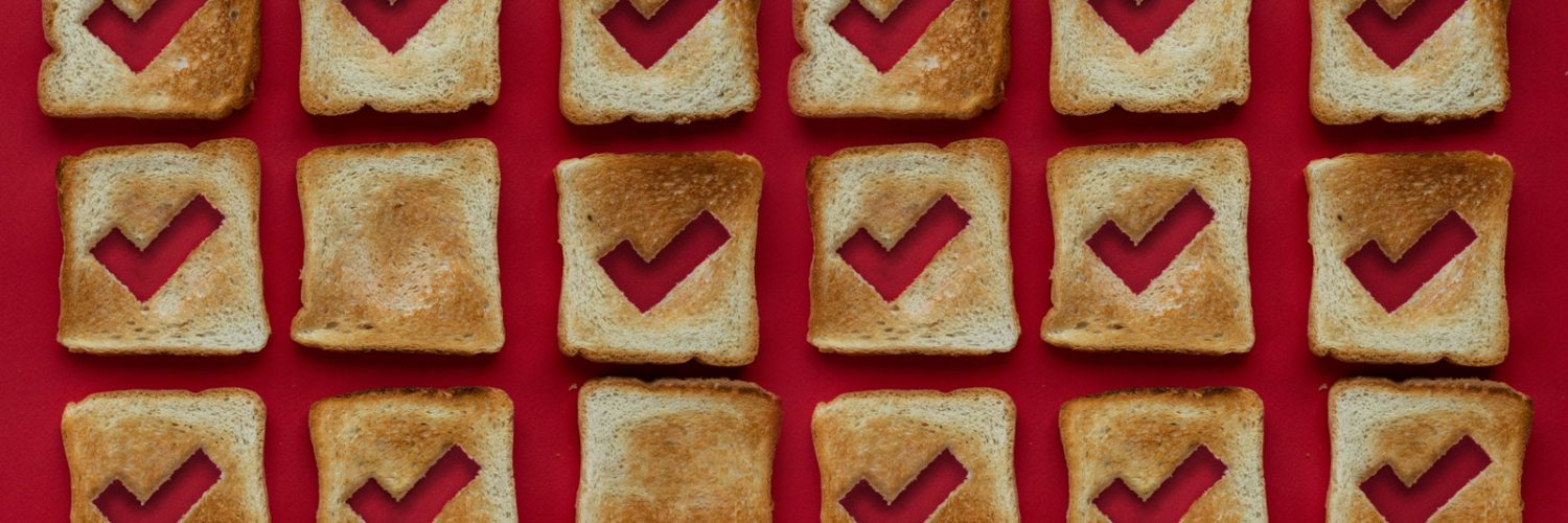 Slices of bread with ticks cut out of them